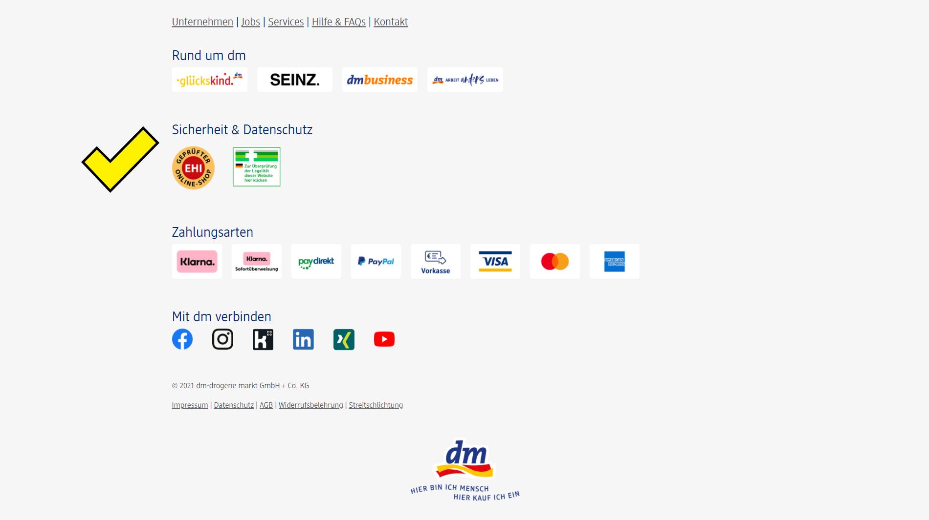 Screenshot des Footers von dm.de mit Trust-Siegeln