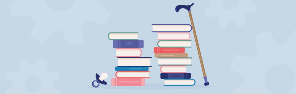 Bücherstapel mit Schnuller und Gehhilfe